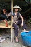 亚裔妇女武装 免版税库存照片