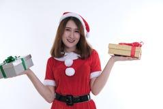 亚裔妇女画象在圣诞老人礼服在白色背景 免版税图库摄影