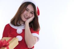 亚裔妇女画象在圣诞老人礼服在白色背景 库存照片