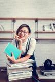 亚裔妇女的图片是愉快从读书学会 免版税图库摄影