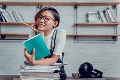 亚裔妇女的图片是愉快从读书学会 免版税库存照片
