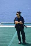 亚裔妇女近海直升机飞行员是在近海抽油装置 免版税库存图片