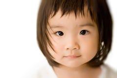 亚裔婴孩表面清白的人 免版税库存照片