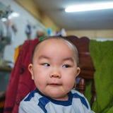 亚裔婴孩Defocus照片  免版税库存图片