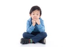 亚裔孩子得到乏味 免版税库存照片