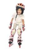 亚裔小女孩演奏直排轮式溜冰鞋 免版税库存图片