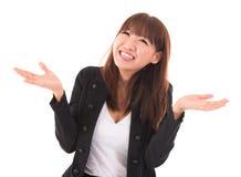亚裔显示难以相信的表示的女实业家开放胳膊 库存照片