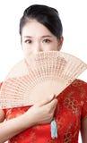 亚裔朱红色的妇女 免版税库存图片
