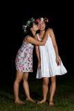 亚裔泰国女孩亲吻在友谊感觉的面颊 库存照片
