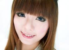 亚裔甜微笑女孩 免版税图库摄影