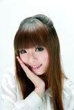 亚裔甜微笑女孩 免版税库存图片