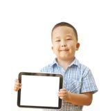 亚裔男孩与片剂的6年 免版税库存图片