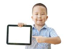 亚裔男孩与片剂的6年 图库摄影