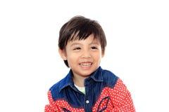 亚裔男孩安排一点微笑 库存图片