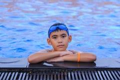 亚裔男孩愉快的游泳 库存照片