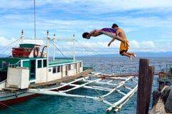 亚裔男孩潜水的端口 免版税图库摄影