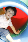 亚裔男孩逗人喜爱的操场 免版税库存照片