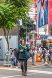 亚裔繁忙的妇女 免版税库存图片