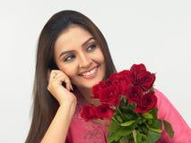 亚裔红色玫瑰妇女 免版税图库摄影