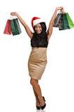 亚裔美丽的圣诞节购物妇女 免版税库存图片