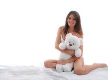 亚裔美丽的女孩微笑的玩具 免版税库存照片