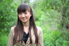 亚裔美丽的室外纵向妇女 免版税库存照片