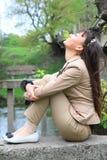 亚裔美丽的室外纵向妇女 免版税图库摄影