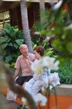 亚裔老人和妇女画象  免版税库存照片
