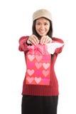 亚裔运载的礼品女孩华伦泰 库存图片