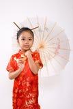 亚裔逗人喜爱的女孩一点 免版税库存照片