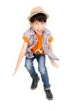 亚裔逗人喜爱的男孩跳与微笑面孔 免版税库存图片