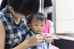 亚裔逗人喜爱的婴孩装饰 图库摄影