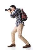 亚裔年轻男性背包徒步旅行者拍照片 免版税库存图片