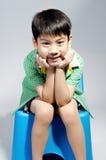 亚裔年轻逗人喜爱的男孩画象  免版税图库摄影