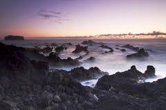 亚速尔群岛:日落在Mosteiros 免版税库存图片