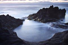 亚速尔群岛:日落在Mosteiros 免版税库存照片