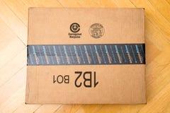 亚马逊在木地板上的最初箱子 免版税图库摄影