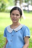 亚洲人孕妇是休闲在公园 图库摄影