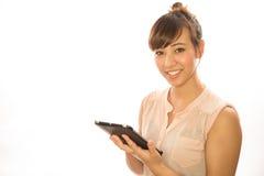 亚洲人拉提纳使用片剂个人计算机的女孩妇女 免版税库存图片
