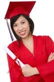 亚洲人毕业生俏丽的妇女 免版税库存图片
