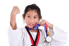 亚洲人白色背景的跆拳道女孩 免版税库存照片