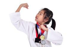 亚洲人跆拳道女孩有背景 免版税库存图片
