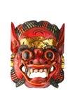 亚洲传统木红色绘了在白色的邪魔面具 免版税库存照片
