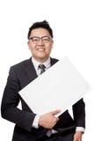 亚洲商人展示一个倾斜地空白的标志 免版税图库摄影