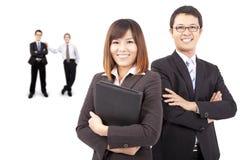 亚洲商人微笑的小组 免版税库存图片