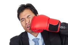 亚洲商人被猛击对他的面孔 库存照片