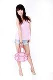 亚洲女孩手袋粉红色 免版税库存图片