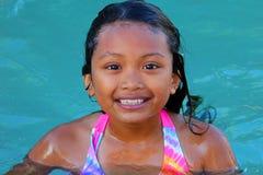 亚洲女孩游泳 免版税图库摄影