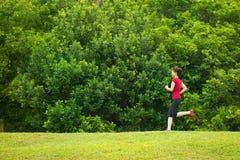 亚洲女孩跑步 免版税库存图片