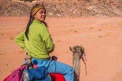 亚洲女孩骑马骆驼 图库摄影